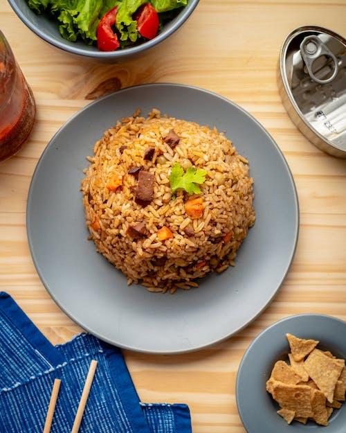Brown Rice on Blue Ceramic Plate