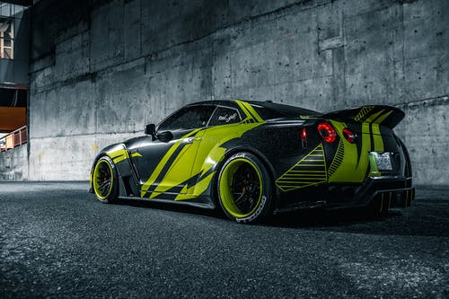 Contemporary sports car on roadway in night city