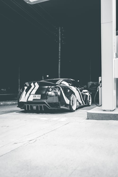Racing auto in gas station at night