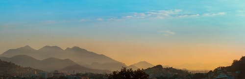 Fotos de stock gratuitas de entardecer, paisagem, paisaje, puesta de sol