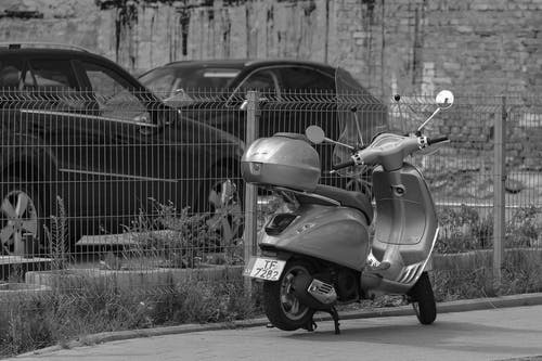 Modern motor scooter parked on roadside