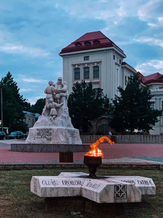 Memorial bonfire and statues near Romanian University