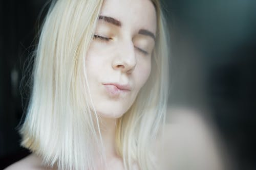Romantic female blond with closed eyes