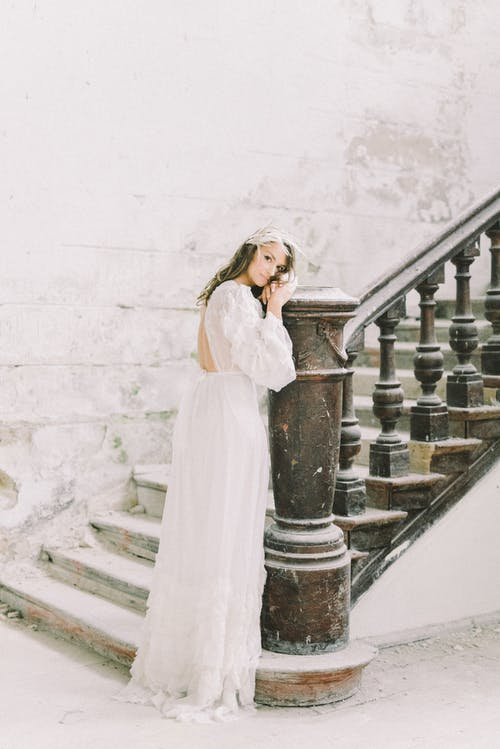 Gentle bride at classic stairs in snowfall