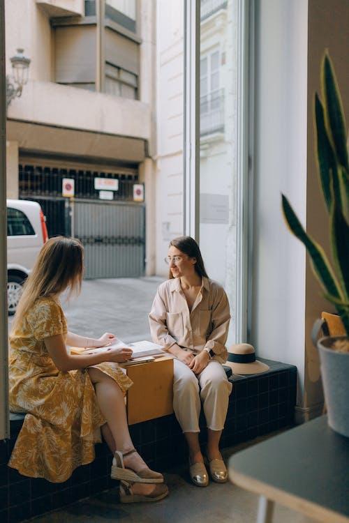 Two Women Having a Conversation