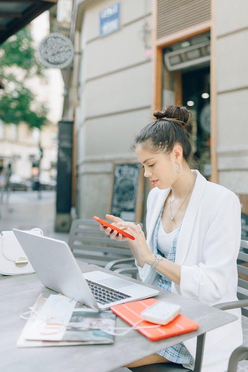 Woman in White Blazer Using Macbook Air