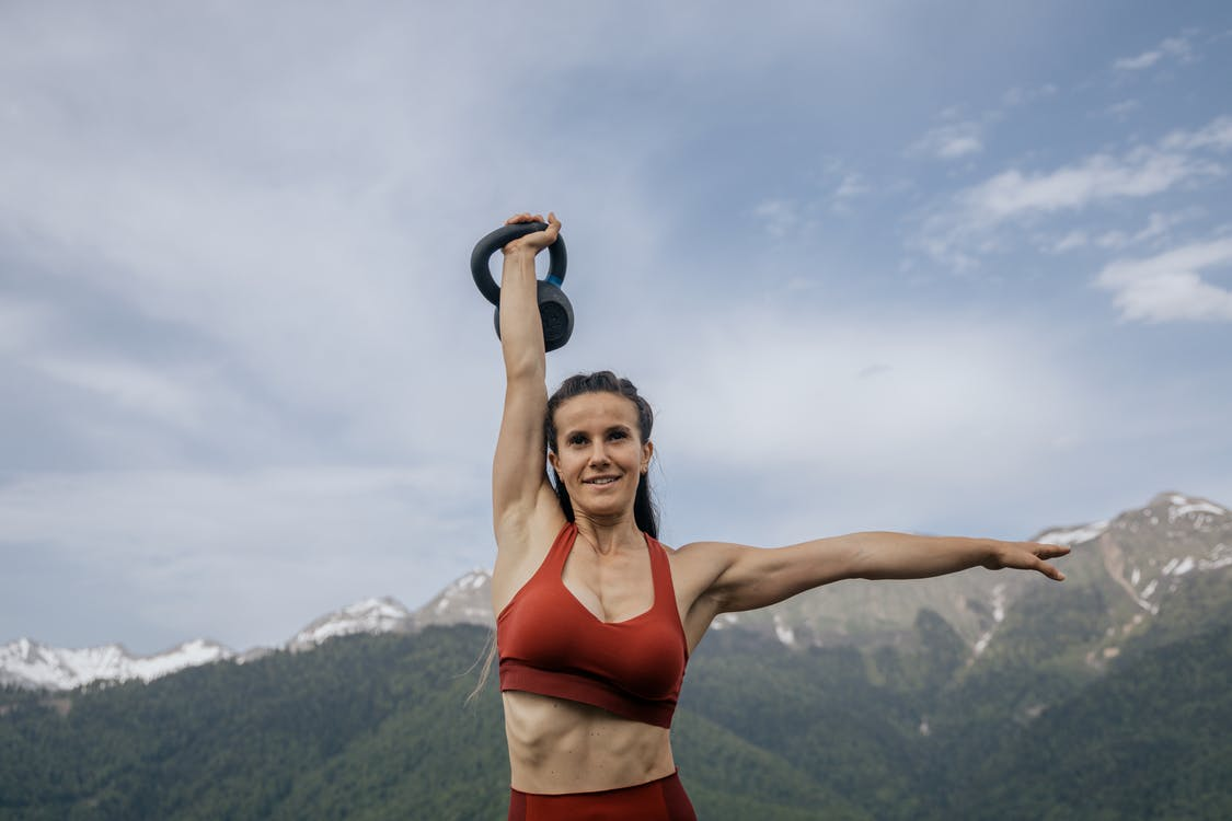 Woman in Red Sports Bra and Red Panty Holding Her Hair