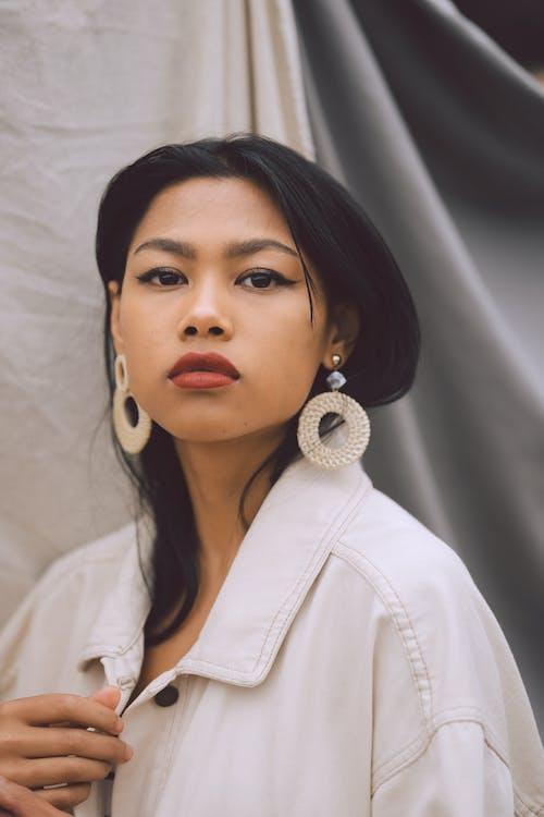 Stylish Asian woman in light room
