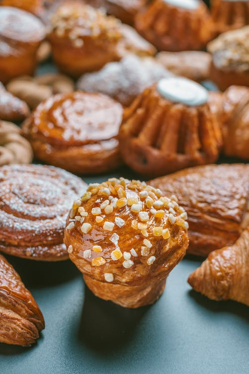 Delicious fresh pastries on black table