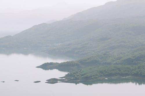 Calm sea flowing near mountains