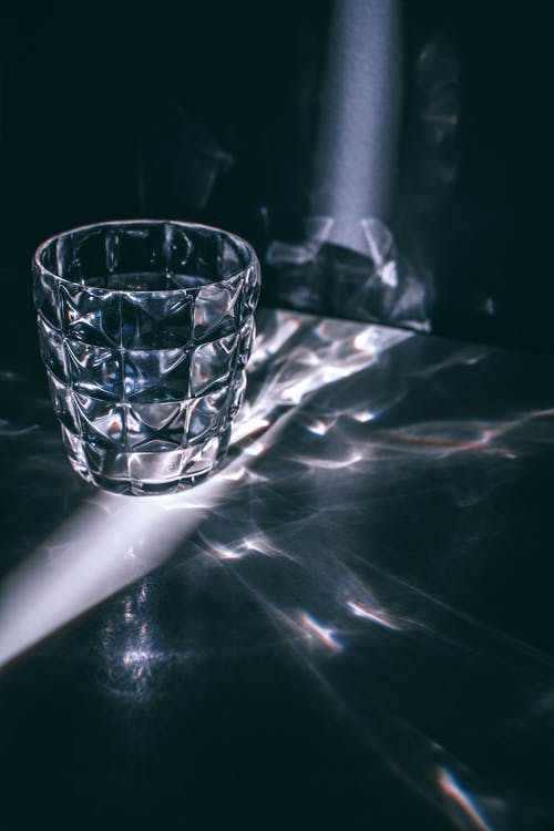 Glass with refraction pattern in darkness