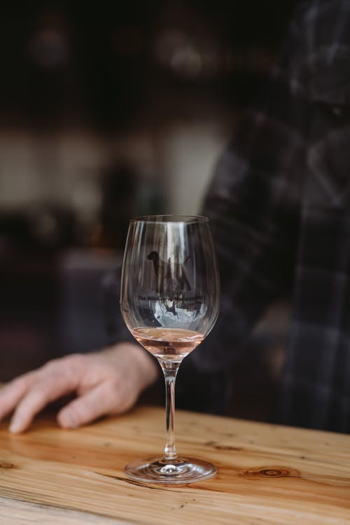 Man resting at table with glass of wine