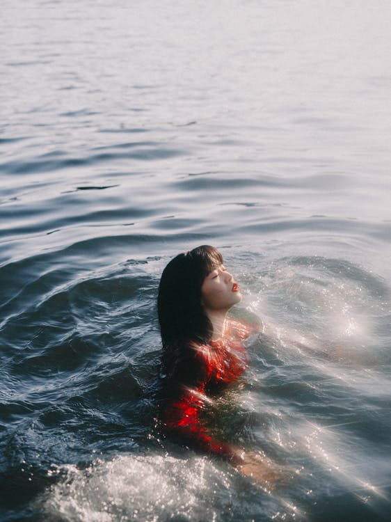 Woman Swimming In A River