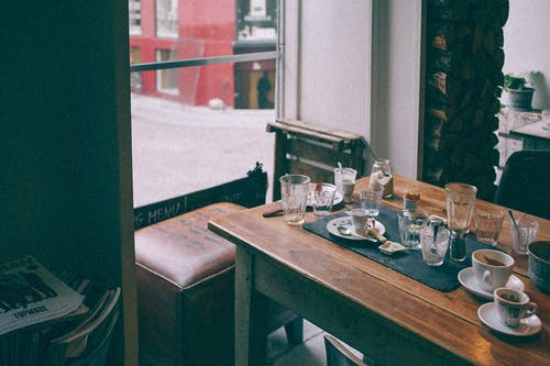 Table with empty dishware in cafe