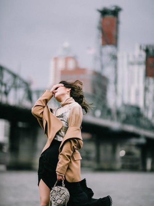 Fashionable young woman with handbag