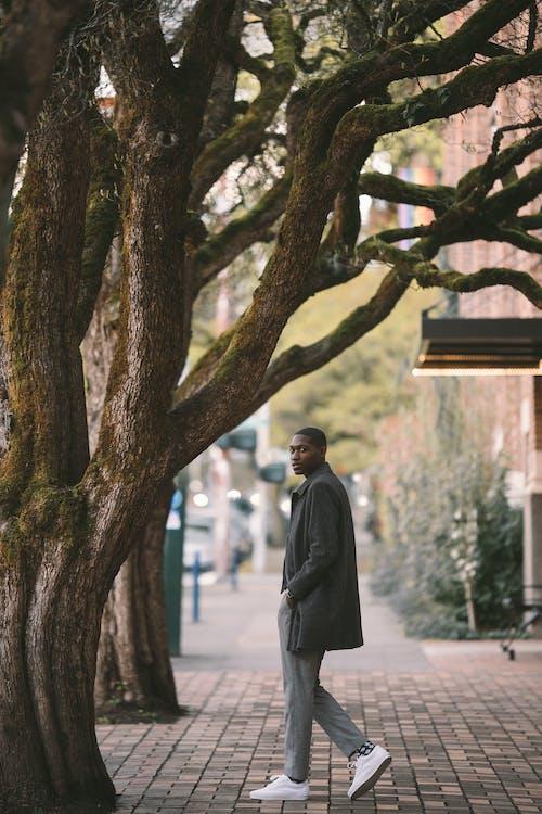 Ethnic man on paved sidewalk