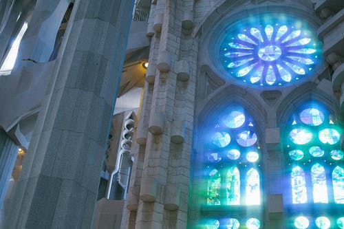 Low angle of old catholic basilica with stained glass windows named Sagrada Familia located in Barcelona in Spain