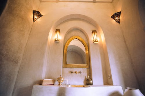Interior of spacious oriental bathroom with mirror