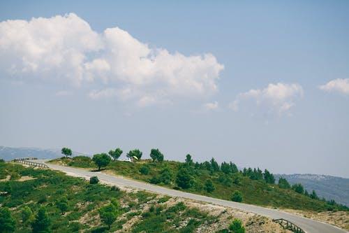 Asphalt road in mountainous terrain