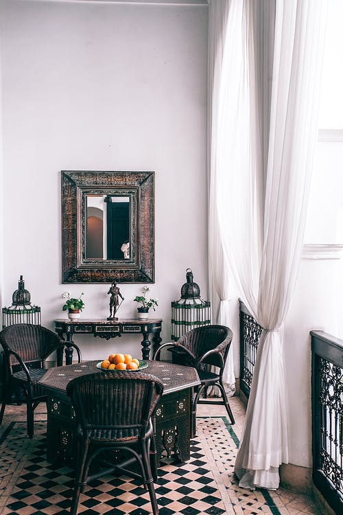 Interior of stylish room with classic design decorated with curtains and old fashioned furniture