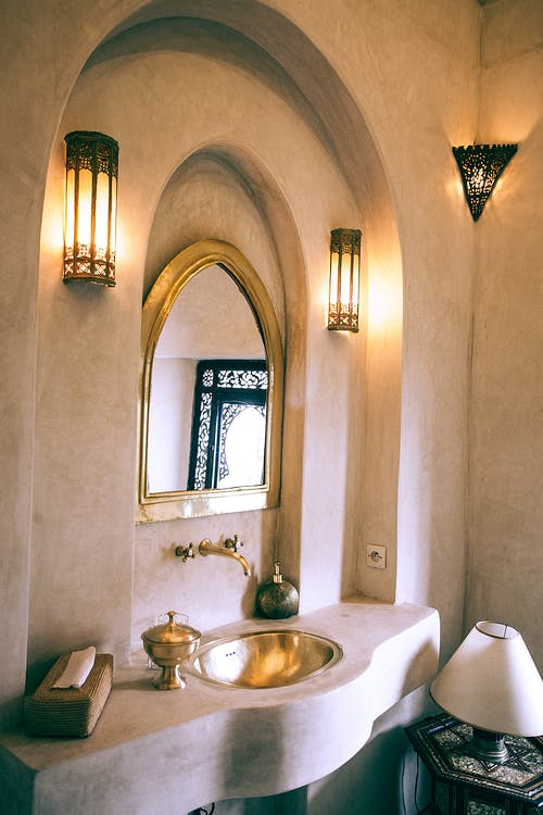 Interior of bathroom in oriental style with arched wall niche