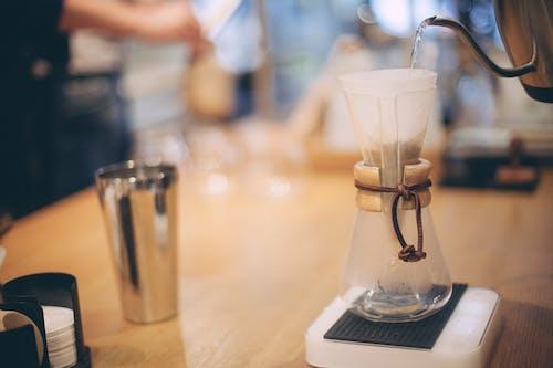 Barista brewing coffee using chemex method