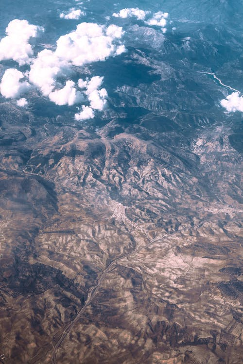 Clouds over high tops in mountainous terrain