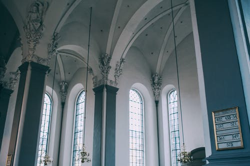 Spacious hall of baroque catholic cathedral with arched windows
