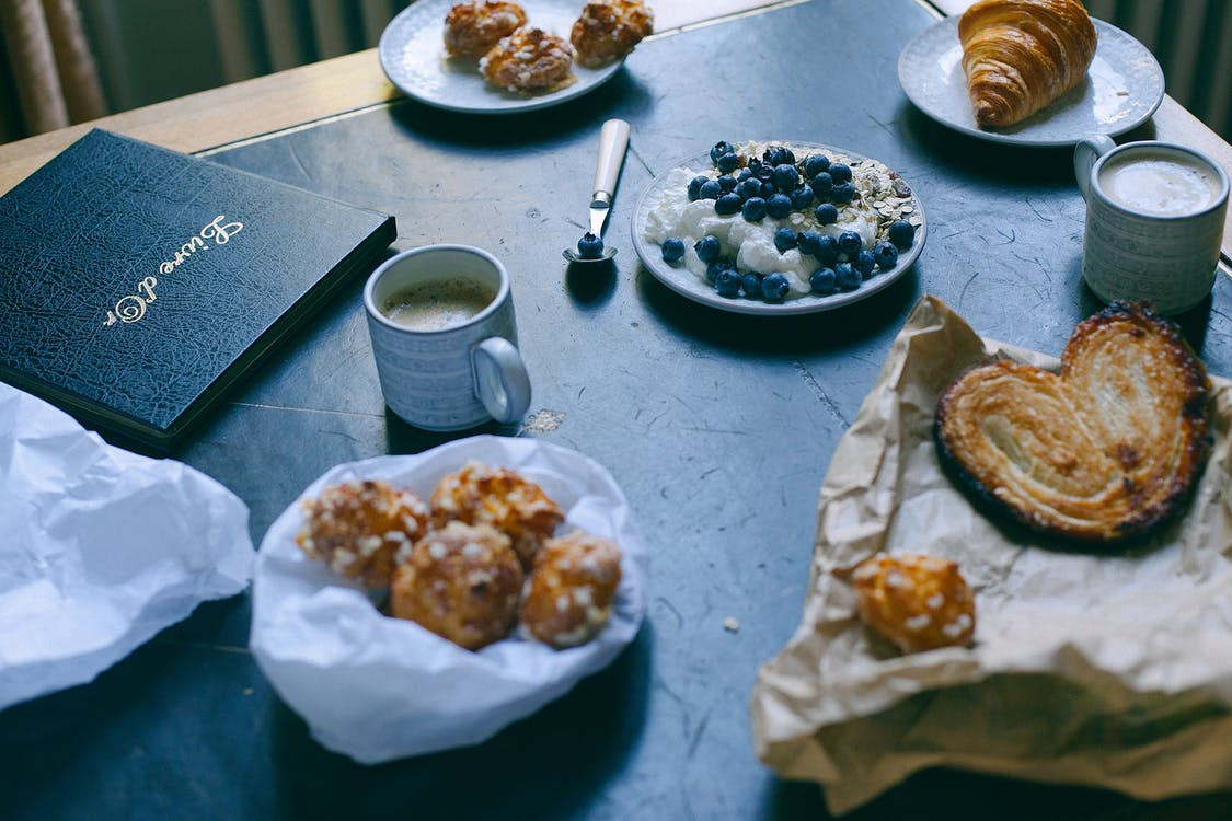 Delicious breakfast with various pastry and cappuccino served in restaurant