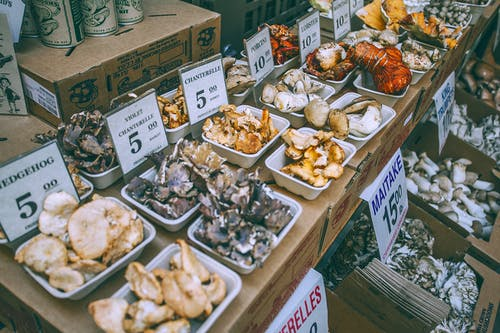 Assorted mushrooms on counter in market