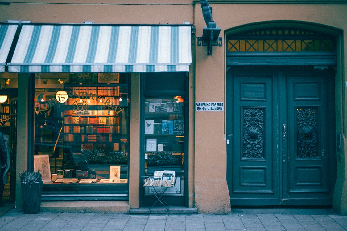 Bookstore building facade on pavement in city