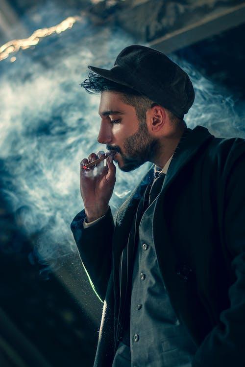 Man in Black Hat Smoking