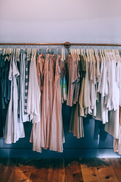 Collection of female clothes on rack in boutique