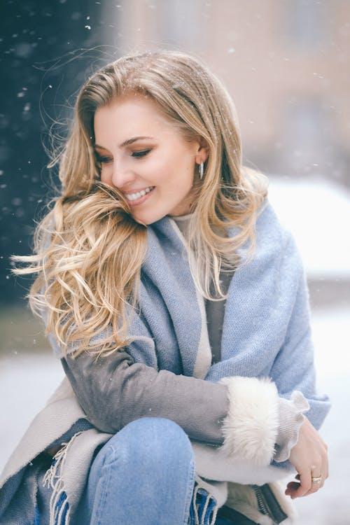 Girl in Gray Coat Holding White Plush Toy