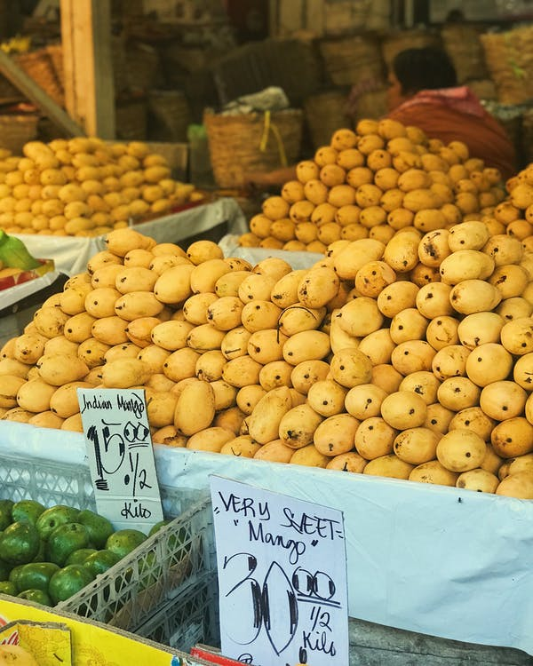 Yellow Round Fruits on White Plastic Crate