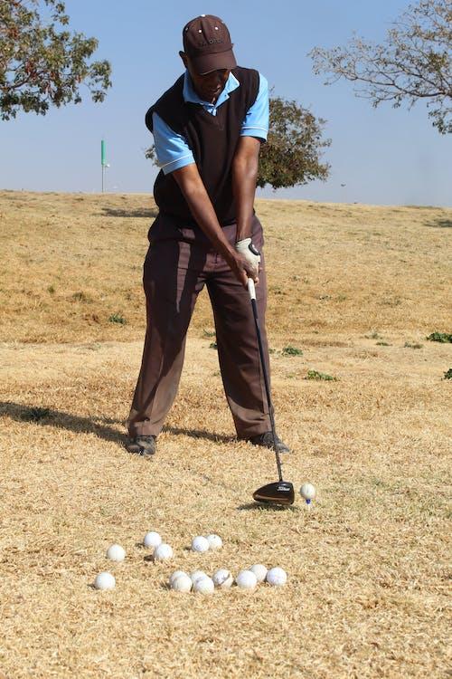 A Golfer in Driving Range