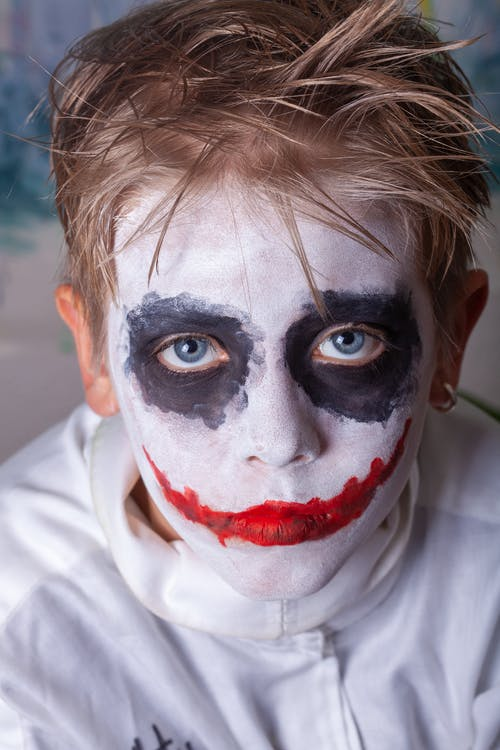 A Person with Red and Black Face Paint