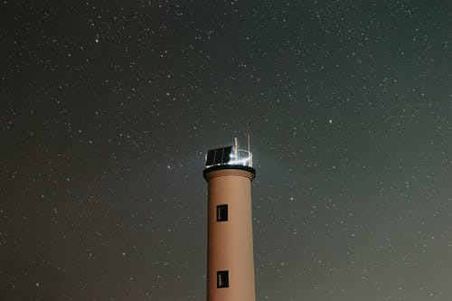 Luminous tower of lighthouse in night
