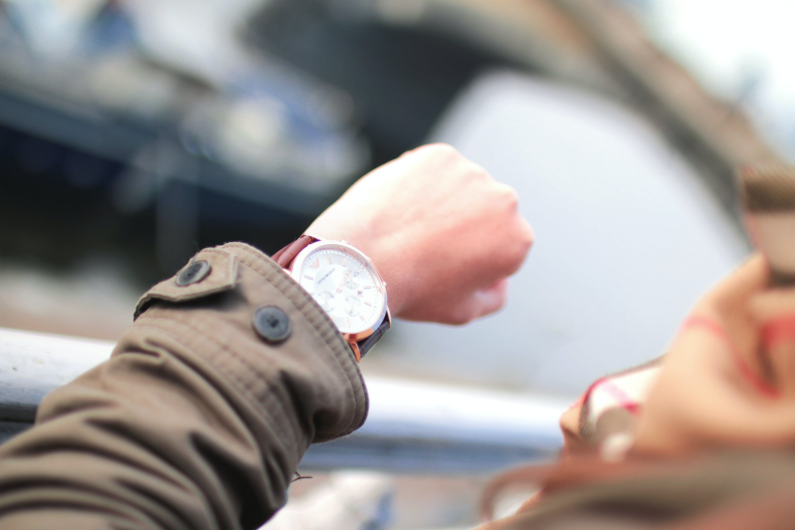 Selective Focus Photography of Person Watching Watch