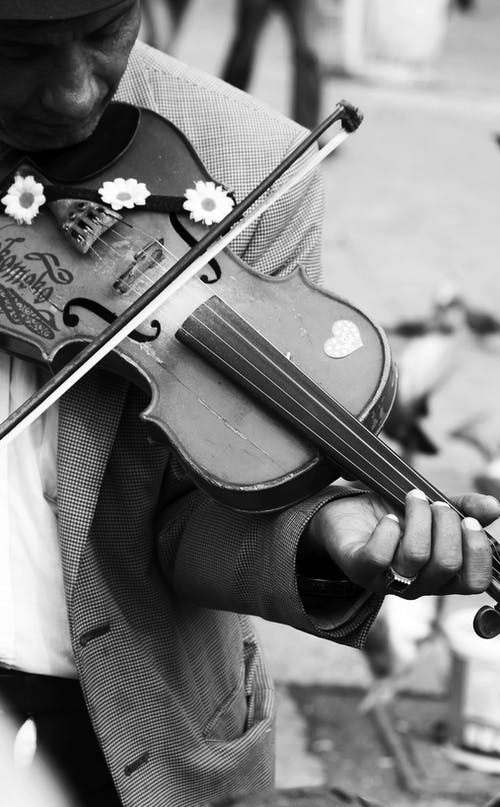 Person Playing Violin in Grayscale Photography