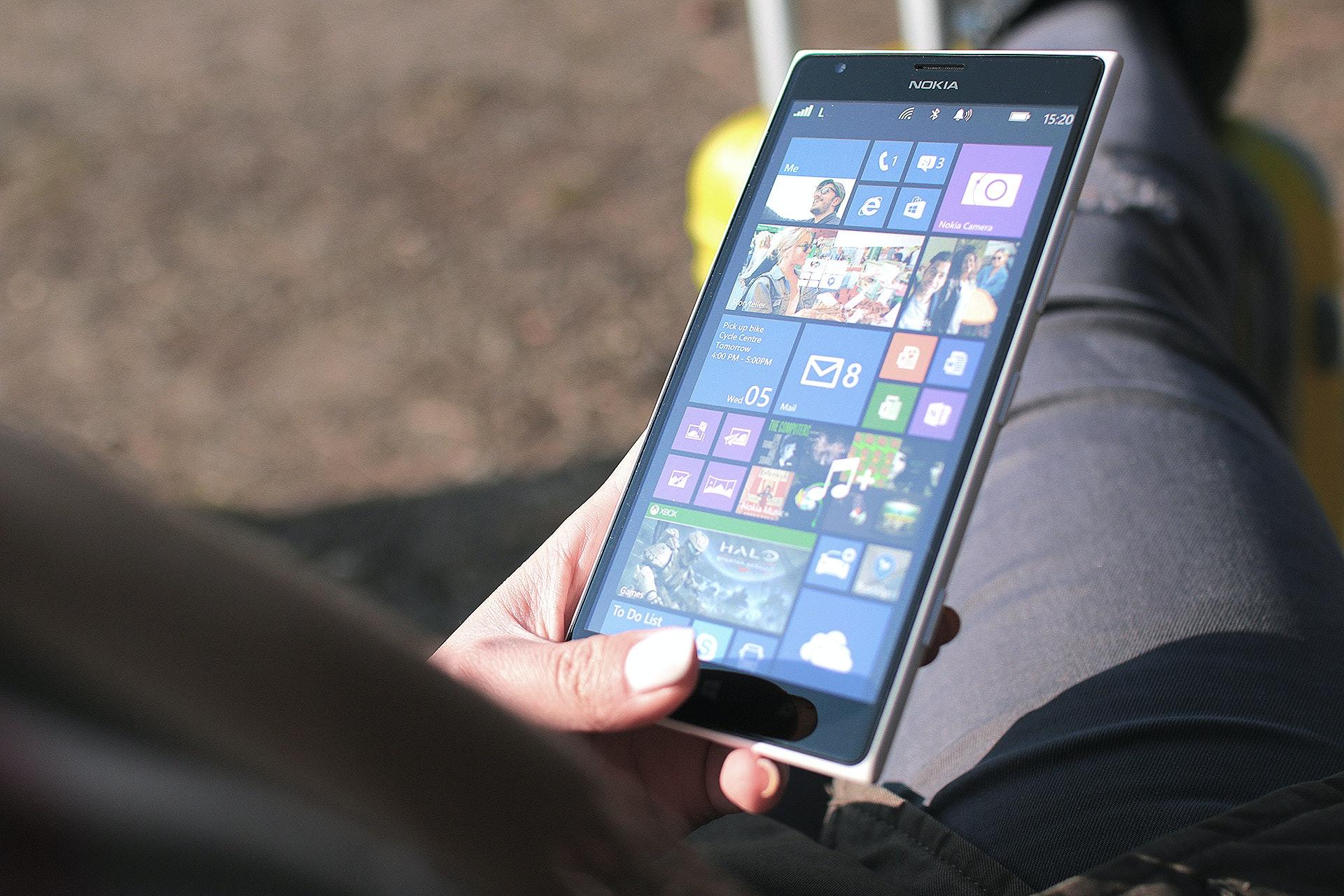 Person Using Black Nokia Windows Phone · Free Stock Photo