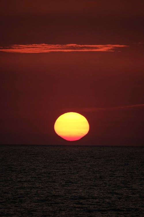 Amazing bright sunset over wavy sea