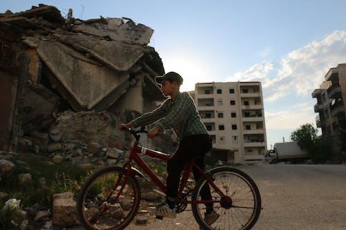 Boy riding bicycle on street