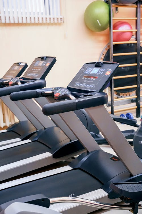 Interior of gym with modern treadmills