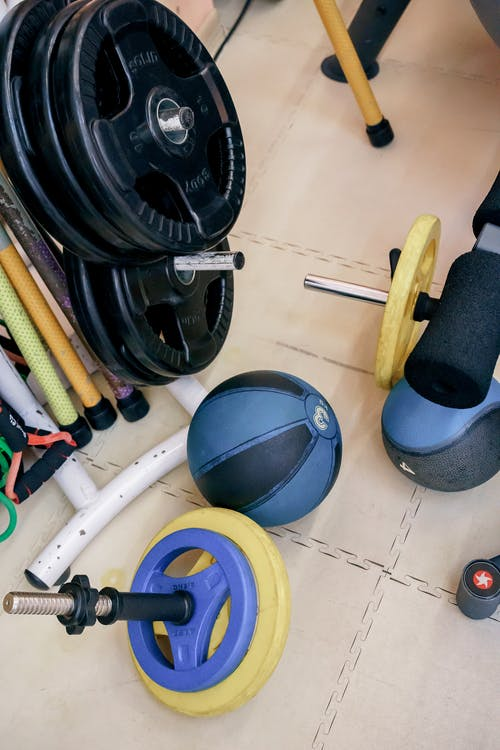 Various weight equipment in modern gym