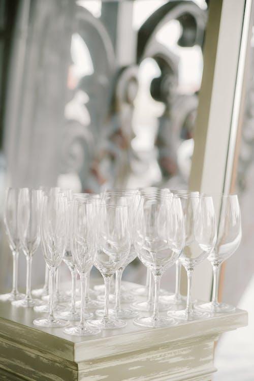 Elegant crystal glasses placed on table during wedding celebration