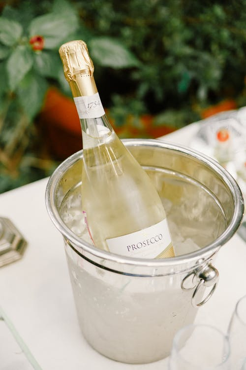 Champagne bottle in ice bucket on banquet table