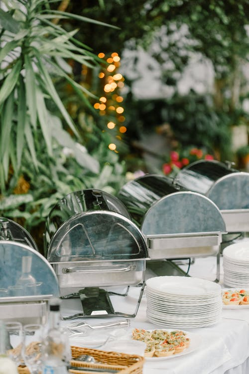 Banquet table with dishware and food