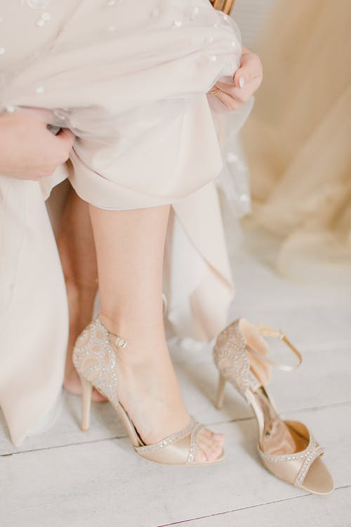 Elegant bride in wedding dress and shoes