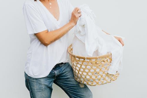 Woman in White Shirt Holding White Textile